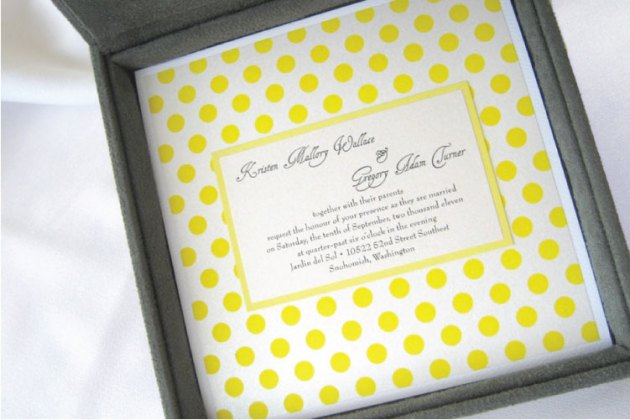 Yellow and gray polka-dotted wedding invitation in invitation box
