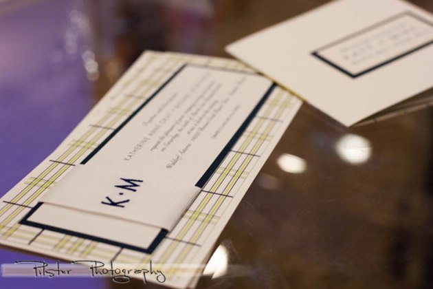 Lime and blue wedding invitation with embroidered monogram on ribbon