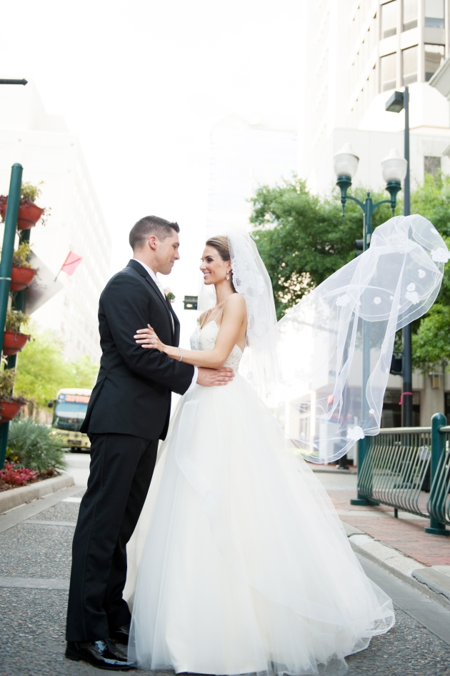 Scott Craig Photography, Dogwood Blossom Stationery, Orlando weddings, bride and groom on street