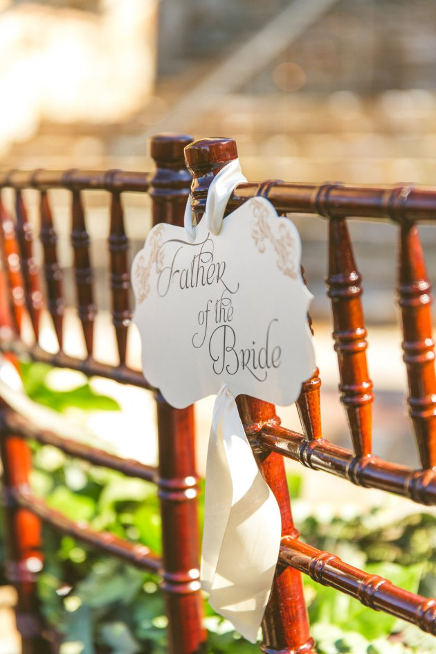 Bella-Collina-Concept-Photography-Fairytale-Wedding-Ideas-Chair-Signs-White-Floral-Shutterlife-Productions-Beautiful-Music-Dogwood-Blossom-Stationery-Event