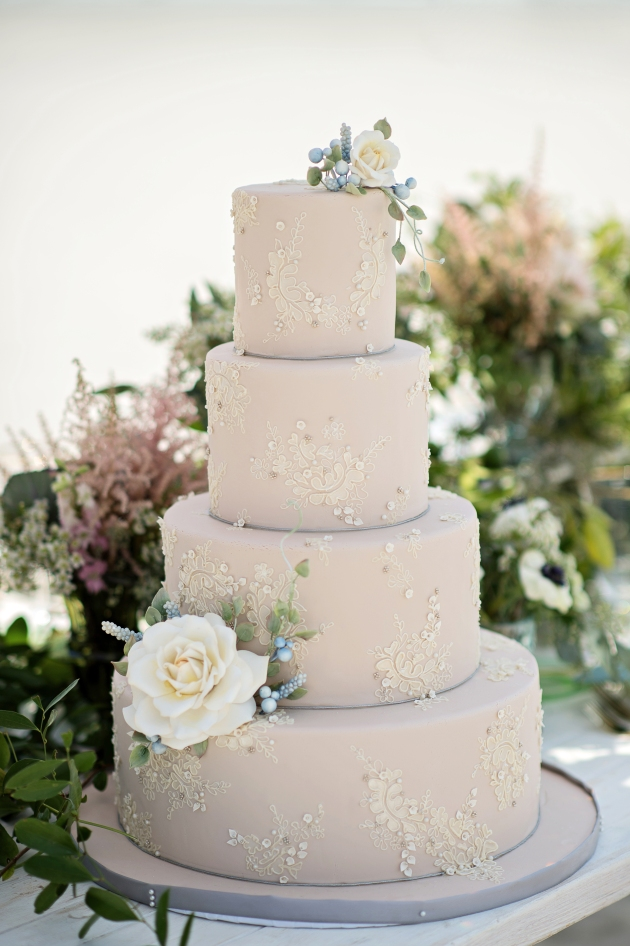 Cream wedding cake with appliques