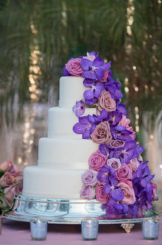 White cake with purple flowers